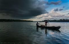 Divided by light (Vidhu S Pillai) Tags: water rain boat fishermen kerala monsoon kollam godsowncountry keralatourism kollampictures vidhuphotography
