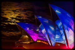 Vivid Sydney 2013: Moonrise over a Brightly Coloured Opera House: Installation 4: Play (Craig Jewell Photography) Tags: light moon color colour reflection wet festival lights iso100 rainbow colorful sydney vivid australia circularquay player fisheye festivaloflight moonrise colourful 135 operahouse lunar glassy cour sydneyoperahouse fisheyelens f63 colorfullight 2013 0ev 50sec ef135mmf2lusm richardlindsay installation4 spinifexgroup vividsydney canoneos1dmarkiv filename20130529215919x0k0391cr2 335125s1511255e
