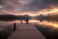 One with Nature (djniks) Tags: lake mountains standing sunrise pier montana alone lonely glaciernationalpark mcdonald gnp canon1740f4 lakemcdonald canon5dmkii