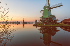 Windmills Galore (Allard Schager) Tags: old longexposure sunset urban holland heritage history water netherlands dutch architecture vintage reflections landscape canal zonsondergang nikon dusk scenic may nederland peaceful windmills calm illuminated historic le mei iconic idyllic neighbourhood touristattraction zaanseschans noordholland zaandam municipality tranquilscene zaanstreek paintlike rustique zaandijk zaanstad northholland pittoresque olddutch windstil dutchtreat 2013 museumarea pictoresque d700 nikond700 nikkor2470mmf28 nikonfx allardone allard1 allardschagercom