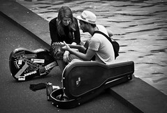 Serenade in Black and White (Les Unsworth) Tags: street musician music triangle guitar candid performance australia melbourne victoria southbank diagonal yarra busker serenade