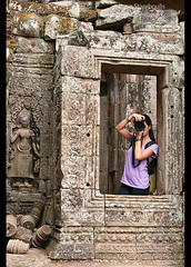 Photographer enjoying the Bayon temple at Angkor Wat in Siem Reap, Cambodia (jitenshaman) Tags: camera travel art stone architecture asian temple photography photo ruins asia cambodia khmer photographer artistic angkorwat carving unesco temples destination siemreap angkor unescoworldheritage bayon stonefaces angkorian jayavarman prasat worldlocations
