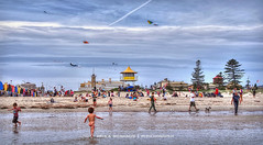 Busy day at the beach (Paula McManus) Tags: kite playing beach children olympus adelaide familyfun southaustralia kiteflying semaphore omd theport surflifesaving portadelaide semaphorebeach em5 14150mm paulamcmanus surflifesavingtower