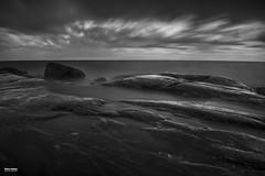 Stones (salas-3) Tags: coast water longexposure stones sky dramatic blackwhite nikon photography seascape sea finland