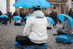 161009_SAM_9286 (Jan Jacob Trip) Tags: germany berlin brandenburgertor pariserplatz umbrella meditation pavement sitting rain blue white brown classicism column streetphotography people berlijn duitsland