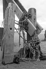 Tied in knots (Camperman64) Tags: withernsea holderness eastyorkshire coast groynes ropes tangled bolts smooth worn waves beach
