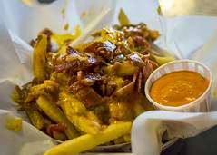 Moo Fries (Dtek1701) Tags: moocreamery centralvalley food eats grub xt1 35mmf14 handheld indoor naturallighting fixedfocallength primelens mirrorless xtranssensor xmount xseries xshooter foodtography california kerncounty local frenchfries bacon caramelizedonions cheese spicy1000sauce