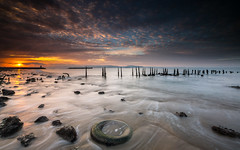 The day after  [ explore 30|11|2016 ] (marcolemos71) Tags: seascape sea water waves pillars oldpier rusty tire rubber stones sand sky clouds sun sunrise lowtide longexposure leefilters leesw150 leend09h cruzquebrada oeiras portugal marcolemos