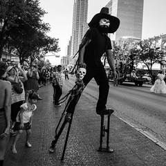 Viva La Vida  -  3 (-Dons) Tags: austin texas unitedstates vivalavida vivalavidafest diadelosmuertos stilts mask congressavenue girl street