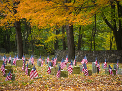 Remembrance (RobertCross1 (off and on)) Tags: 75300mmf4867mzuiko boston em5 ma malden massachusetts melrose newengland omd olympus autumn cemetery fall flag flags graveyard leaves stone wall