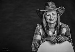 Louise (handmiles) Tags: mono monochrome blackandwhite bw model louise women modelnight hat accesory cowgirl pose look indoor inside blackbackdrop background backdrop smile sony sonya77mark2 sonya77m2 tamron tamron18200mm mileshandphotography2016