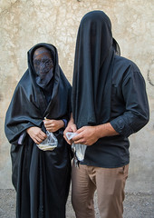 Portrait of iranian shiite muslim couple with their faces hidden by a veil mourning imam hussein on tasua during the chehel manbar ceremony one day before ashura, Lorestan province, Khorramabad, Iran (Eric Lafforgue) Tags: 2people 30s adultsonly ashura ceremony chador clothing colorimage couple covered face hidden imamhussein iran islam khorramabad lookingatcamera man memorialevent middleeast mourners mourning muharram muslim mysterious mystery niqab outdoors people portrait religion religious ritual shia shiism shiite sugar tasoua tasua twopeople unrecognizableperson veil veiled vertical woman lorestanprovince ir