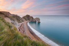 Durdle Door- (Jake Hancock Photography) Tags: beach cliff clouds cloudy coastline colours countryside dawn dorset durdledoor england enviroment forshore geography geology grass green landscape morning nature photography rocks sand sea seascape seasons sky sunrise sunset unitedkingdom water waves jurrassic