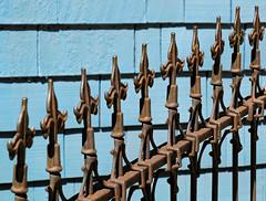 Fleur de Lis Fence (Colorado Sands) Tags: sandraleidholdt hff fence ironwork metal metalfence colorado usa manitousprings fleurdelis wroughtiron decorative wroughtironfence finial