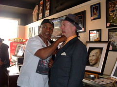 The knockout punch:  Mike Tyson and myself at ManCave Memorabilia (fitzjim) Tags: world portrait man male art sports closeup tattoo movie championship belt tv intense artist fighter lasvegas drawing african pigeons famous champion rollerderby drawings meeting hangover ring autograph american knockout boxer bite africanamerican movies shows halloffame punch workout tough powerful copy edhelms trainer wwe appearance hof signed autographed ceasarspalace fieldofdreams miketyson evanderholyfield heathergraham bradleycooper arthurashe jeffreytambor zachgalifianakis jimfitzpatrick justinbartha inducted undisputedchampion hangover2 malikabdulaziz sfbaybombers cusdamato mancavememorabilia lakihaspicer wwehalloffameclassof2012 disqualifiedforbitingoffpartofholyfieldsear youngestfighter daysofgraceche guevaramao