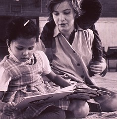 a029886 1950s Preschool (Children's Bureau Centennial) Tags: boy girl reading student teacher 1950s preschool nurseryschool historyofmedicine nationallibraryofmedicine africanamericanchildren childrensbureau