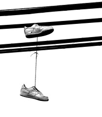 Hanging by a wire... (sharon'soutlook) Tags: blackandwhite bw shoes wires hangingoverwires