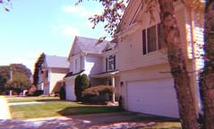 Rose Woods (BoringPostcards) Tags: street houses homes suburban row neighborhood sidewalk suburb