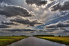The clouds,  the only birds that never sleep. (Wim Koopman) Tags: light sky cloud holland color netherlands dutch silver river canal intense nikon mood meadow dramatic atmosphere polder lining flatland d5200 diitch