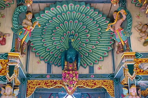 Wood carving and painting of a peacock in the shrine/temple at Sumeru Mountain in Muang Boran (Ancient Siam) in Samut Prakan, Thailand