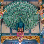 Wood carving and painting of a peacock in the shrine/temple at Sumeru Mountain in Muang Boran (Ancient Siam) in Samut Prakan, Thailand thumbnail