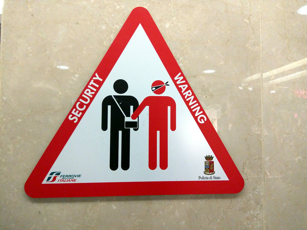 Pickpocket warning sign, train station, by gruntzooki, on Flickr