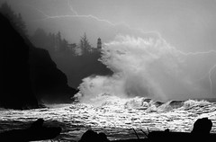 Stormy Weather (Michael Swaja Photography) Tags: blackandwhite cape disappointment wa washington weather waves ocean sea storm thunder lightning winter rough spray trees lighthouse light fog hills cliffs scenery nature landscape driftwood logs nikon d5100