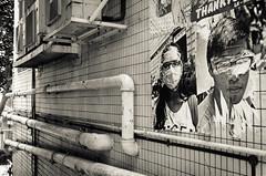 Hongkong 2015 - 01 (colorskyn) Tags: hong kong hongkong ducts rohre fassade facade poster blackwhite schwarzweiss