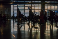 Final call (_Kyriakos) Tags: travel airplane airport call doha dress early final gate hamad international luggage morning people red travellers walk