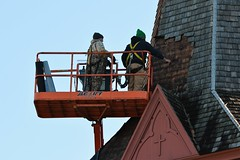 Pulling Shingles off of the Steeple (rabidscottsman) Tags: scotthendersonphotography church construction shingles workers working manlift historicchurch restoration beautiful constructionworkers historic cross crucifix lutheran stjohnslutheranchurch mn minnesota redwingminnesota eastavenue saturday weekend fixing nikon nikond7100 d7100 christianity wood nikkor nikkor70200f28vrii intheair offtheground labor hammer men harness safetyharness tethered camoflauge day331