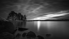 November (jarnasen) Tags: nikon d810 nikkor 1635mmf4 tripod longexposure le sky clouds bnw mono monochrome blackandwhite conversion nd16 formatthitech ndfilter jrnlunden hackelbo stergtland sverige sweden island trees lake reflections rocks perspective sun afternoon sunset nature outdoor nordiclandscape landscape lakescape copyright jarnasen jrnsen light surface smooth mood winter snow november greyscale tones bw explored explore