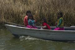 lake titicaca kids in boat (juiceSoup) Tags: puno bolivia lake titicaca