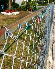 Happy Fence Friday!!! (LarryJay99 ) Tags: chair westpalmbeach lines happyfencefriday fence urban perspective photostream florida sidewalk chainlinkfence iphone7plusbackdualcamera399mmf18