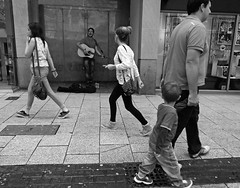 The Singist (Andy WXx2009) Tags: streetphotography candid children boys women outdoors femme men urban blackandwhite monochrome people guitar livemusic singers buskers streetartists cardiff girls wales europe walking shopping parent style street musician