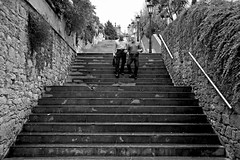 Friends (Daniel Nebreda Lucea) Tags: friends amigos street calle stairs escaleras city ciudad urban urbano people gente two dos men hombres walk andar down bajar black white blanco negro texture textura pattern patron canon 60d asturias oviedo spain espaa shadows sombras motion movimiento capture captura