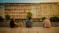 Communist sight (zoomion) Tags: bucharest romania people sitting dog sunset building sight communist wall concret