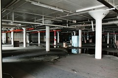 Floor 2 north wing (Withered Perception) Tags: trees windows roof plants signs santafe color abandoned colors metal stairs floors handle fire fan chains amazing lab colorado paint doors factory exterior view gates steel interior bricks elevator pipes pipe cement broadway tracks tire pins off denver rubber structure falling filter wires walkway views vacant labs boardwalk walkways growing fans machines capacitor filters elevators knobs extinguisher carts valves pulley shovels overhead crain rolling racks trough factories pulleys capacitors rotted extinguishers flickrandroidapp:filter=none