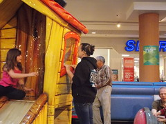 Mer looks at Alex through a Window (Marina A. Miller) Tags: baby alex rain marina mall shopping fun day play rainy burnaby meredith brentwood angelyna tarya