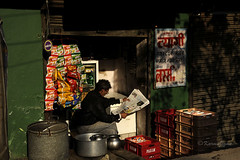 The reader (karmajigme) Tags: shop newspaper store magasin reader journal lecteur