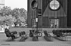 """Now Boarding"" Copyright 2012 DANE COLFAX STEPHENSON (Dane Colfax Stephenson) Tags: blackandwhite bw man black bicycle waiting chairs humor streetphotography irony dane now boarding colfax stephenson blackwhitephotography"