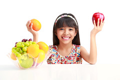 Happy little asian girl sitting on the table with plate of fruit, Isolated on white (Patrick Foto ;)) Tags: portrait people food orange white cute apple girl beautiful smile vegetables childhood fruit kids female studio children asian fun thailand happy person one kid healthy child natural little sweet eating background joy young lifestyle happiness fresh health snack thai vegetarian hungry organic diet care cheerful grape isolated nutrition vitamin clippingpath