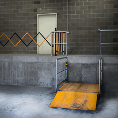 Loading Dock with Lift (Dr Abbate) Tags: door brick industry wall architecture square concrete bay dock gate lift interior empty transport platform nobody warehouse partition loading lenstagger