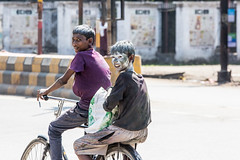 Bye (Gigin - NoDigital) Tags: boy people india colors face bicycle other kid colorful asia objects powder transportation laugh geography activity bodyparts jaipur holicolorfestival