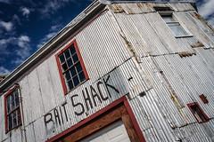 Bait Shack (FotoFloridian) Tags: maine portland newengland architecture abandoned harbor waterfront decay wharf docks window rundown building blue sky facade urban