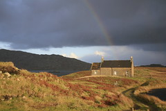 At the end of the rainbow (lesleycc53) Tags: cottage rainbow landscape autumncolours water hills dramaticsky northuist scotland