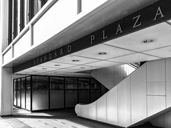 Standard Plaza, East Entrance (rowjimmy76) Tags: standardplaza portland pdx pnw pacificnorthwest bw black white architecture building urban city escalator office iphone6