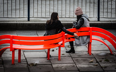 On My Wavelength (DobingDesign) Tags: southbank london modifiedsocialbenches streetphotography streetfurniture jeppehein modifiedsocialbenchesny curve fluorescent orange colourpop women people talking together two couple street londonstreets centrallondon citylife lines line stripe colour color bright saturated smoking