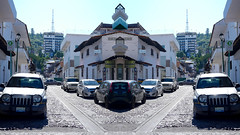 024POV (Symic) Tags: andrswilliamolsenrodriguez port vallarta mexico symmetry road reflect mirror street cobble hills green up ascend tower buildings cars line shop shopping