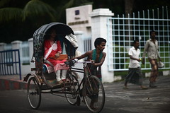 Beauty can hide anywhere, everywhere.... (N A Y E E M) Tags: rickshaw girl red pedestrians ramadan lateafternoon street candid navalavenue chittagong bangladesh sooc raw unedited untouched windshield