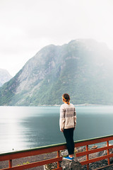 The first time I saw Fjord (Dima Viunnyk) Tags: norway travel girl rain lake fjord water beautiful beauty nature mountain fance fog stand vsco majestic alone outdoors